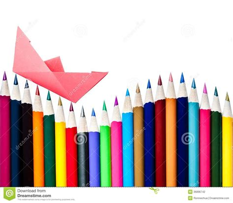 Paper Boat On An Array Of Color Pencils Stock Photography
