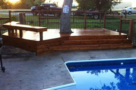 denton tx poolside deck incorporates existing tree