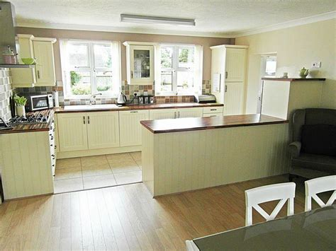 Kitchen Floor Units by Photo Of Olive White Kitchen With Floor Tiles