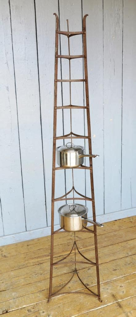 large  standing wrought iron pan stand rack