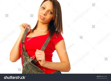 A Beautiful And Sexy Brunette In Casual Clothing Overalls