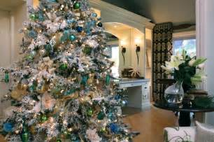 white flocked christmas tree with shades of blue transitional living room san diego by