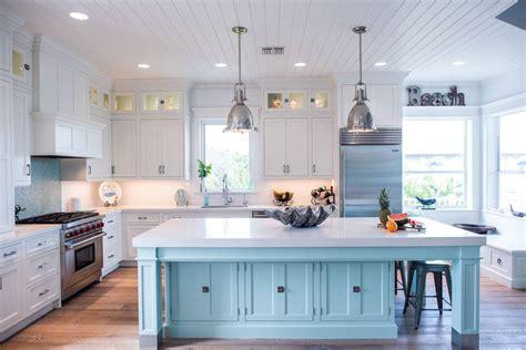 Coastal Style White Kitchen With Blue Island  Crystal