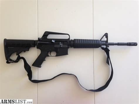 ARMSLIST - For Sale: Bushmaster AR-15 fixed carry handle XM-15