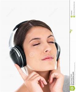 Stock Photos: Female listening to peaceful music on white ...