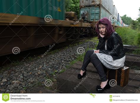 Sad Runaway Teen Girl Waits For Train To Escape Her