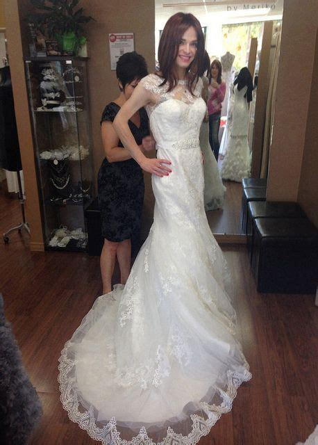 beautiful bridal crossdresser is being fitted for wedding gown transgender brides