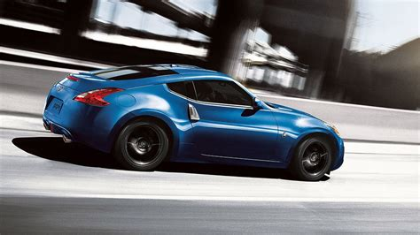 2015 370z 174 coupe touring shown in midnight blue nissan 370z nissan 370z nissan 2015 nissan