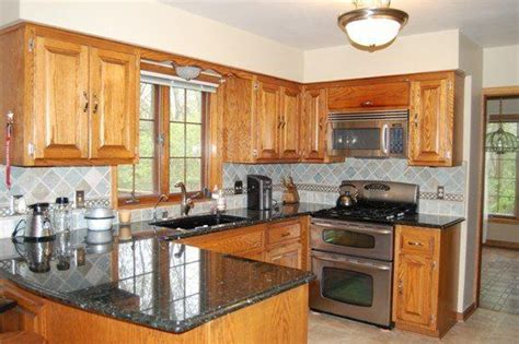 painted kitchen cabinets with black appliances questions painting wood trim where to stop oak 9052