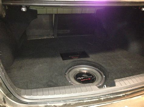 custom subwoofer enclosure spare tire well