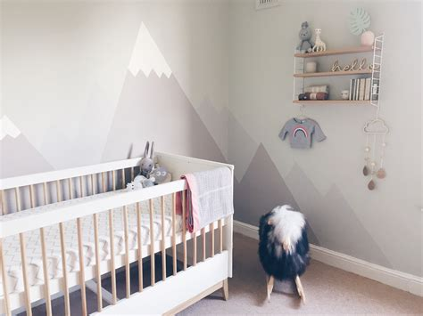A Gender Neutral Pastel Nursery With Mountain Mural J