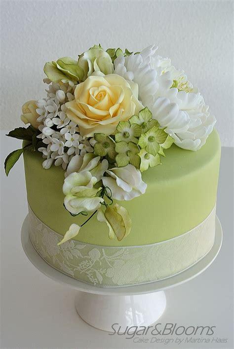 sugar flower cake  soft green  yellow shades