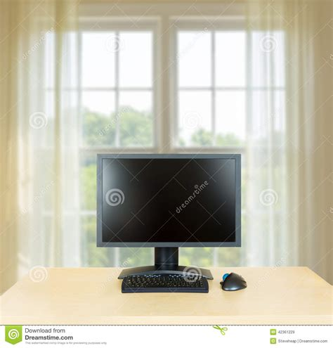 bright light computer screen plain office desk with monitor with window stock photo