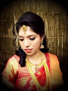 Traditional South Indian bride wearing bridal saree and jewellery Reception look Makeup by