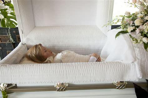 Beautiful women in their caskets. Liana Kotsura in her open casket during her funeral ...
