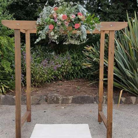 wooden wedding arch  native flowers ceremonies