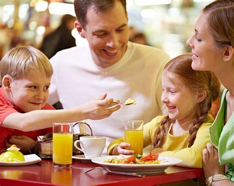 Family Eating Breakfast At Restaurant