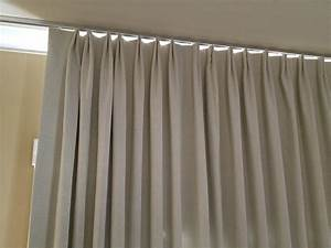 How to hang pencil pleat curtains on a track best home for Pencil pleat curtains on track
