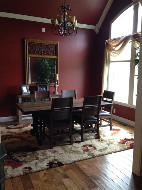 formal dining room  sherwin williams barn red paint