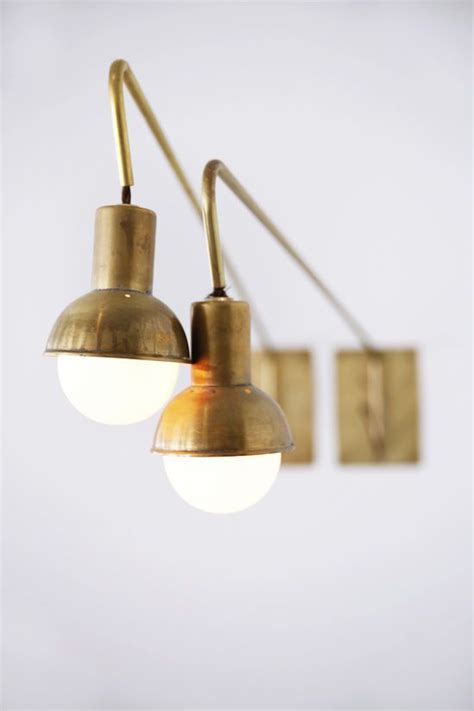 la ostrich farm brass lights white brick and woven elements lights rustic