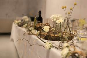 top table decoration rustic wood branches twisted willow jars and bottles top table