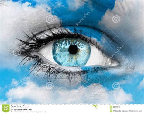 Beautiful Blue Eye Against Blue Clouds