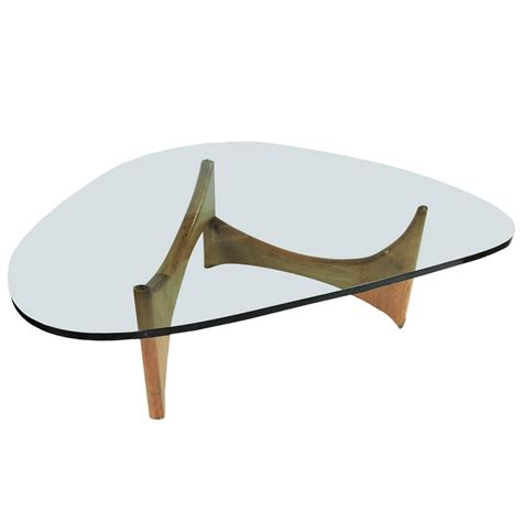 Made of dark brown acacia wood with a contrasting cream coloured storage drawer. Mid-Century Modern Glass and Wood Coffee Table at 1stdibs