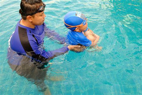 girls swimming  daytime  stock photo