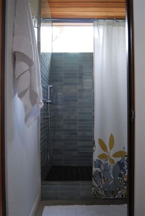 blue wall tile shower curtain bathroom design