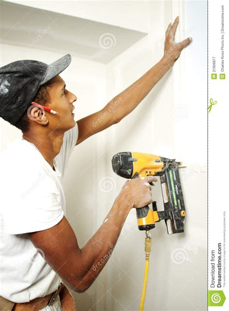 portrait   man drilling   wall stock image image