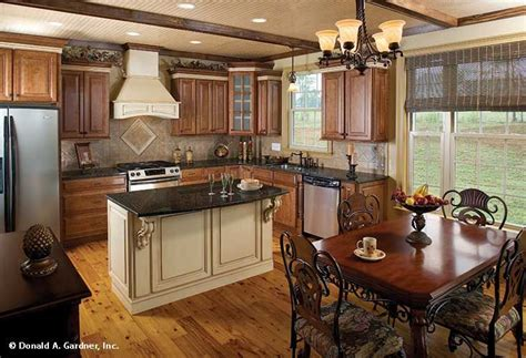 important features in kitchen island this kitchen features an island and opens to a breakfast nook the verdigre 936 delightful
