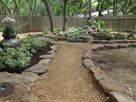 deconstructed granite landscape design ideas stone fire pits water features backyard landscaping austin tx