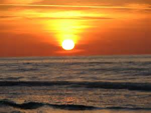 Sun Setting Over Ocean Clip Art