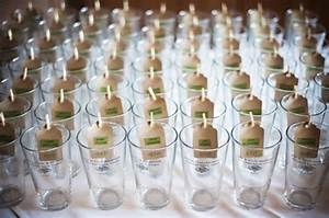 personalized pint glasses serving as escort cards With beer glass wedding favors