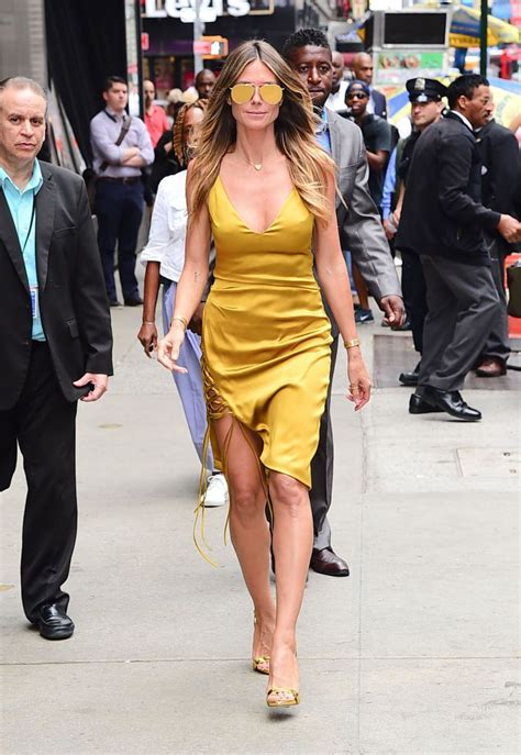 Heidi Klum Turns Heads In Curve Hugging Gold Dress
