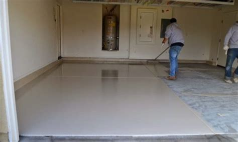 Garage Floor Epoxy Coatings   Men in White Painting