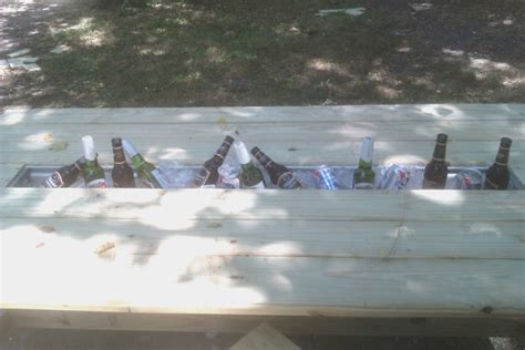 outdoor dining table set with built in drink cooler by