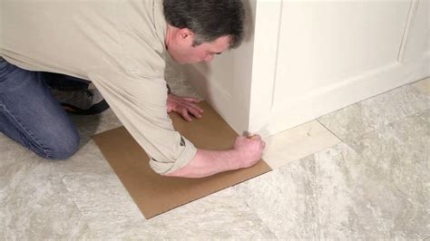 laying tile linoleum glue installing your peel and stick vinyl tile floor