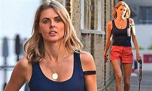 Donna Air shows off her svelte legs during low-key dog ...