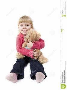 Stock Photography: Little girl sits with a teddy bear ...
