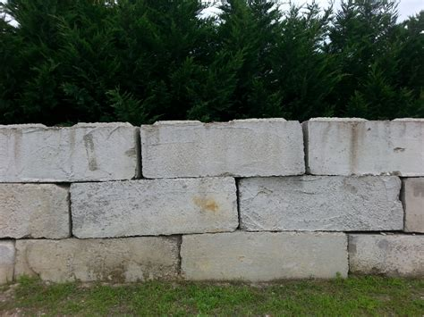 block retaining wall cost retaining wall block raised patio with allan block ashlar pattern red black in stock how to