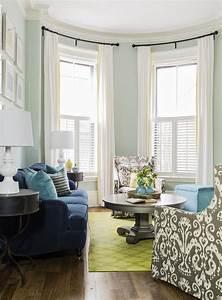 navy blue sofa, gray ikat chairs, light teal walls, lime