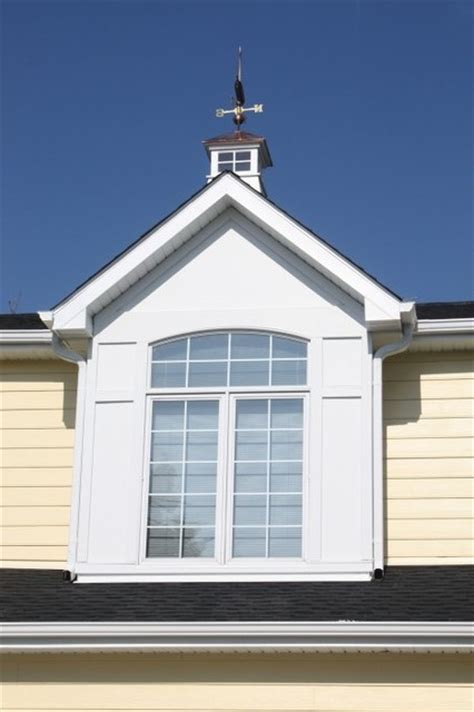 cape  style yellow siding white trim black shutters