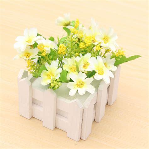 artificial flowers indoor outdoor potted plants wooden