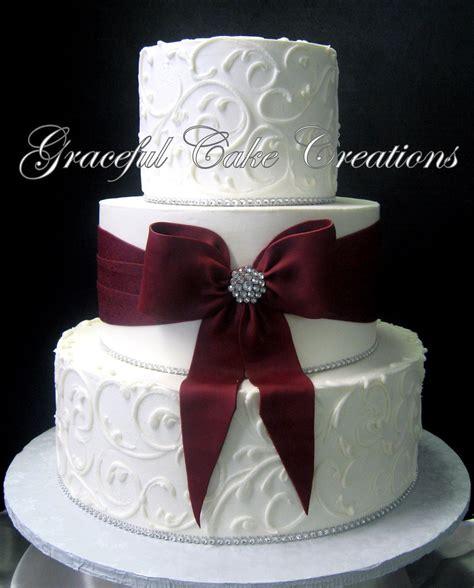 elegant white butter cream wedding cake   burgundy sa