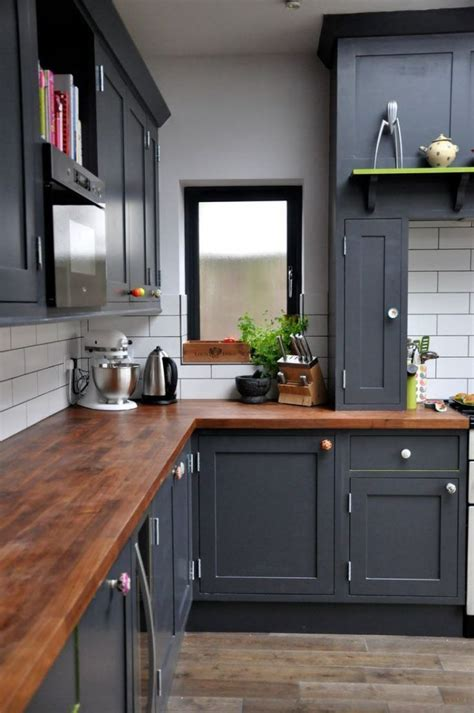 navy blue kitchen cabinets  butcher block counters