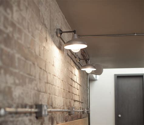 simple cheap wall light exposed conduit industrial wall