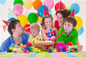 Young Family Celebrating Birthday Party Stock Photo ...