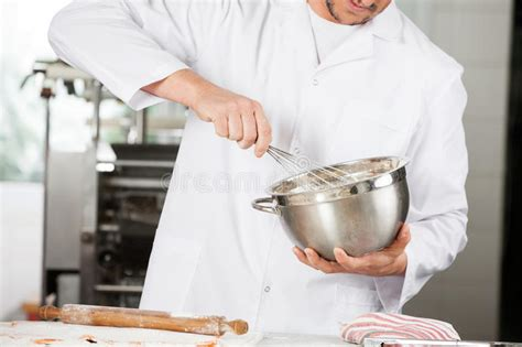 midsection  chef stirring batter  mixing bowl stock