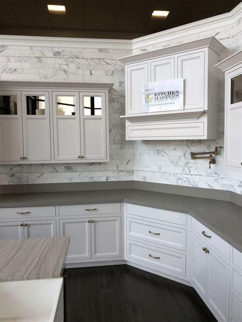 calacatta oro honed marble backsplash    subway tiles